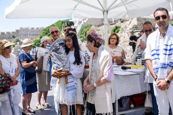 Bat Mitzvah girl walks Torah around