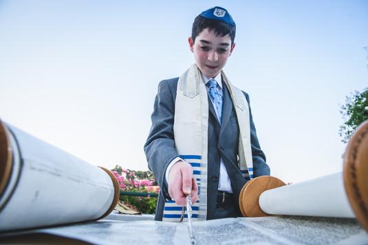 Bar Mitzvah Boy at Mt. Zion Villa reads from the Torah