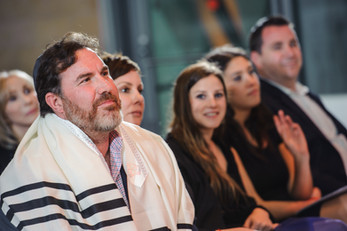 Proud father watching his child's bar mitzvah
