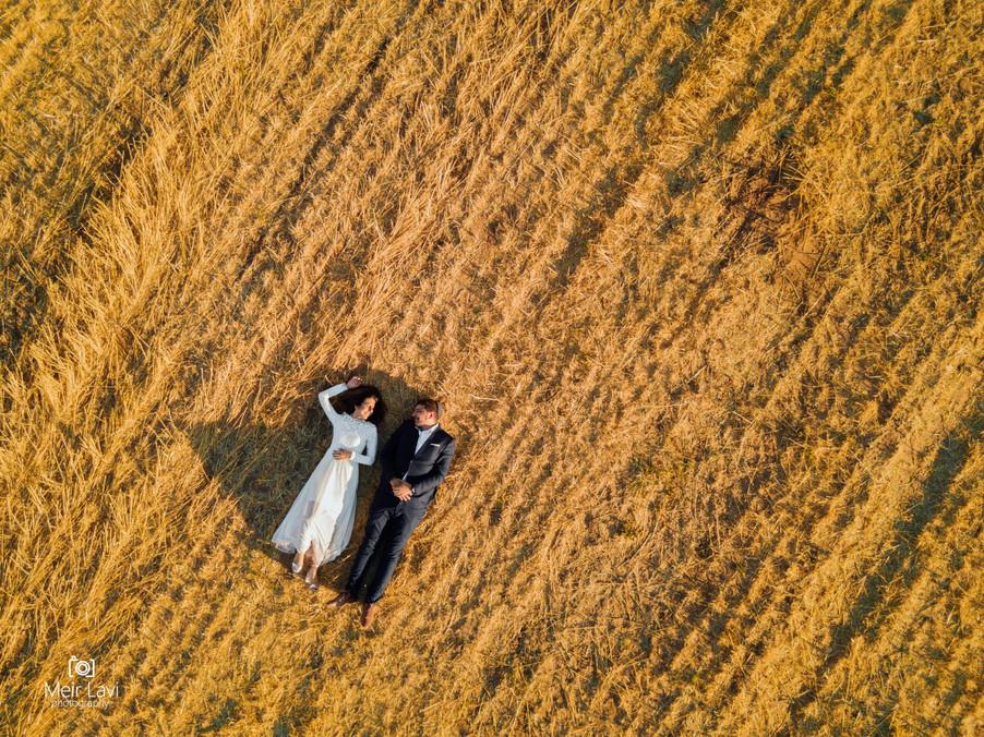 Bride & Groom Lay in Israeli Fields