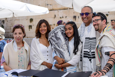 Bat Mitzvah girl Holds Torah with Family and Clergy