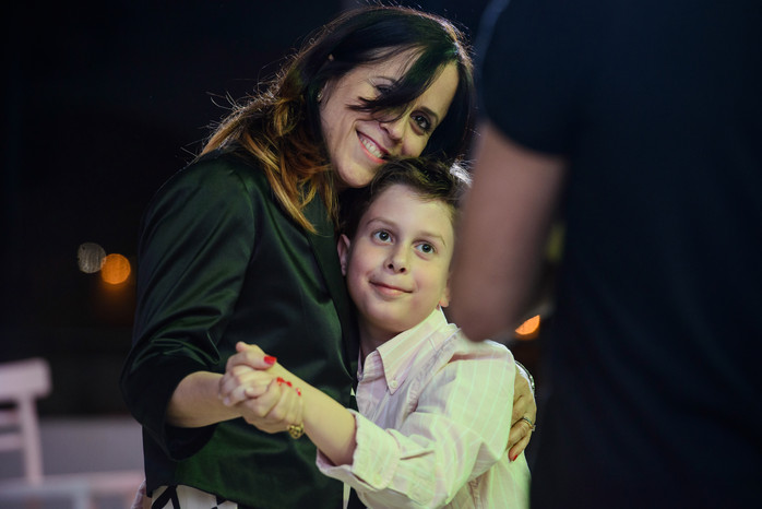 Mother and son dance at Beit Shmuel