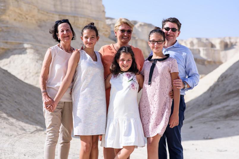 Bnai mitzvah family poses in desert.