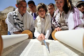 Bar Mitzvah Boy reads from the Torah in Jerusalem
