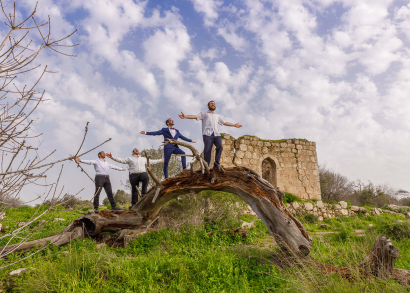Groom and friends in ancient Israeli ruins