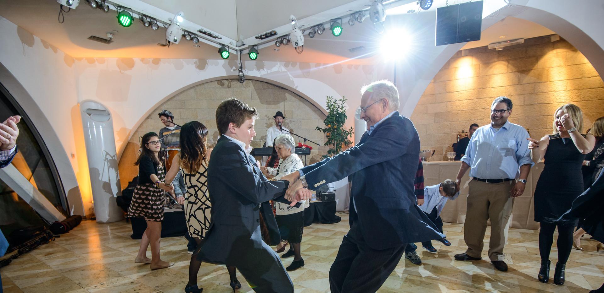 Bar Mitzah boy dances with uncle at Beit Shmuel