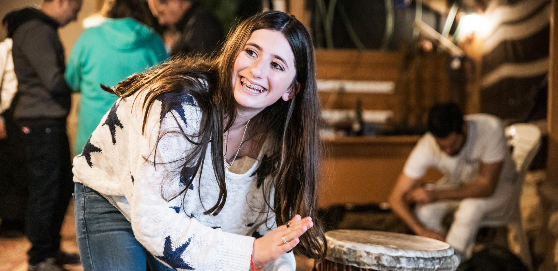 Bat Mitzvah girl pats Jaman's drums
