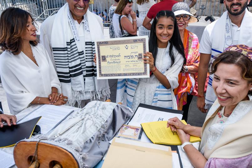 Bat Mitzvah girl shows her Bat Mitzvah Certificate