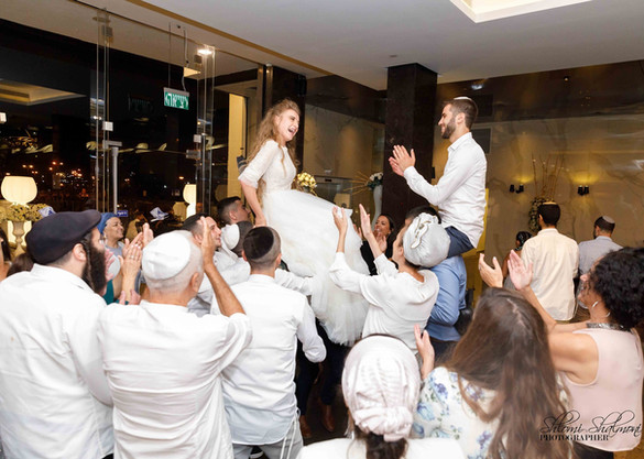 Bride & Groom on lifted on chairs