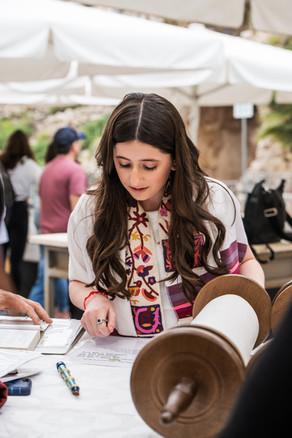 Bat Mitzvah girl reads from the Torah at Esrat Yisrael