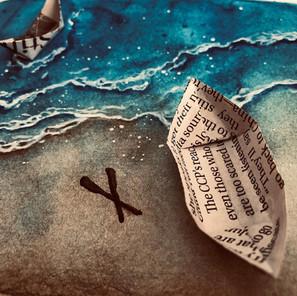 Origami boat on the sea shore