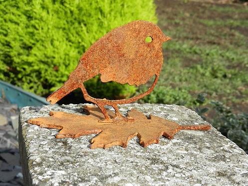 Rusty Metal Robin on a Leaf