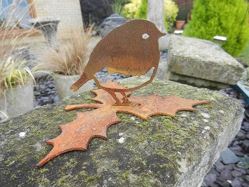 Rusty Metal Robin upon a holly leaf