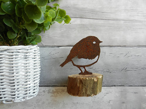 Rusty Metal Robin upon log