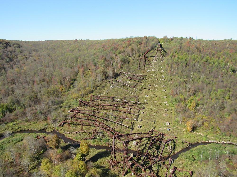 Twisted metal bridge pieces across the floor of the valley