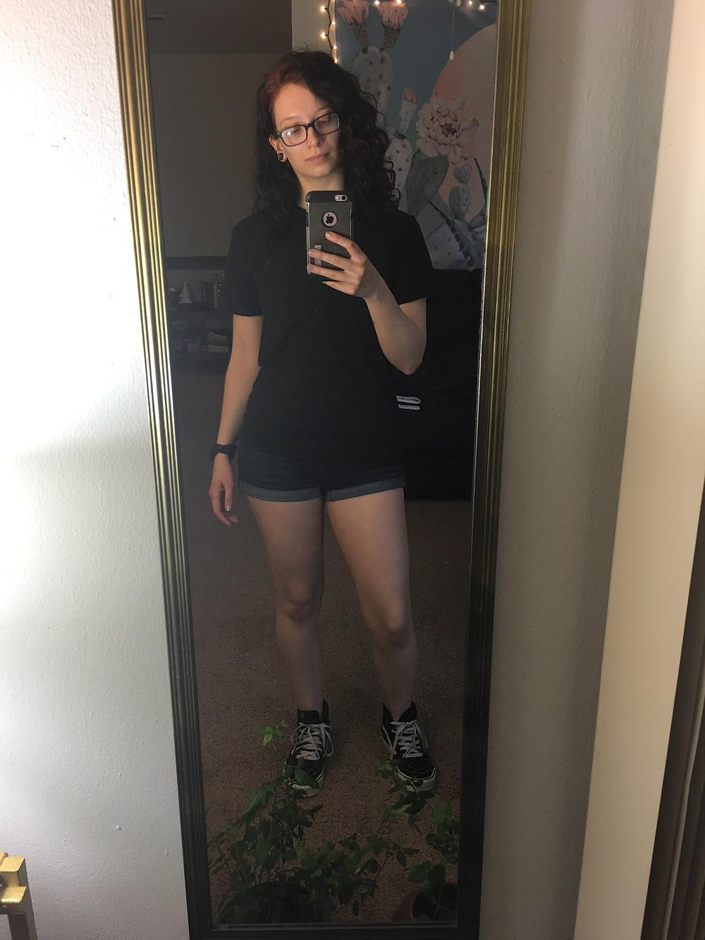 Same shirt, same shoes, plus dark denim shorts