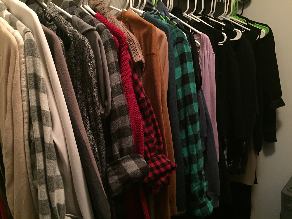 My closet, primarily grey and black, but with some green, red, tan, and blue