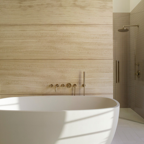 Wine Country Estate: The luxurious wine country escape offers a depth of texture and materials in every room, including the primary bathroom.  Photo credit: Matthew Millman Photography