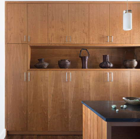 Modern Craftsman: A consistent vocabulary of cherry casework is used throughout the house, including the kitchen.  Photo credit: Paul Dyer Photography