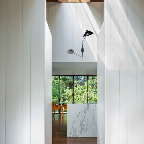 Sonoma Retreat: Statuary honed Calacatta marble cascades over the island in the kitchen, which can be seen as you walk through the front entrance.    The design focus for this wine country getaway was to allow the family to feel, at all times, the deep connection to the land they so love.  Photo credit: David Wakely Photography