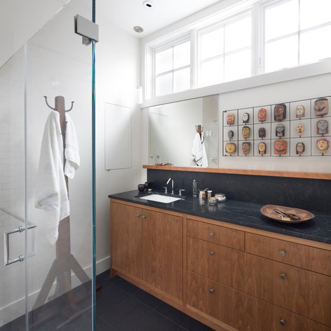 Modern Craftsman: The vocabulary of cherry and infusion of light is evident in the upstairs bathroom.  Photo credit: Paul Dyer Photography