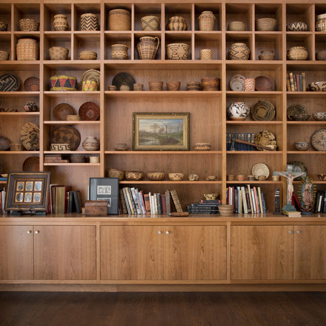 Modern Craftsman: Creating ample gallery space for the owner's Native American artifacts, baskets, craftsman furniture, landscape paintings and other decorative objects was one of the central design moves.  Photo credit: Paul Dyer Photography