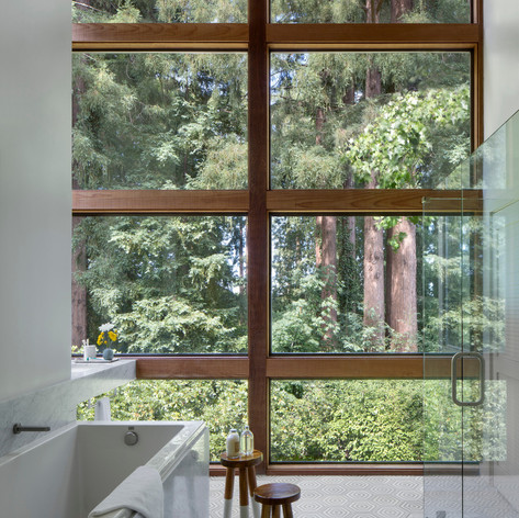 Sonoma Retreat: The guest bathroom features the same leafy views as the guest bedroom.  Photo credit: David Wakely Photography