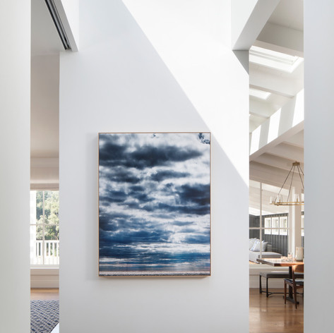 Meadow Estate: A dividing wall between the living room and kitchen is the perfect showcase for artist Eric Cahan's Sky series print. Photo credit: Paul Dyer Photography