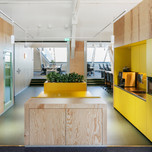 Multifunctional walls of meeting rooms with pantry and telephone boots.  Photo credit: Sonia Mangiapane