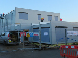 Building modules arrive in Coventry for the first Passivhaus building for the NHS