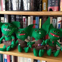 Four little #goblins sitting on a shelf.