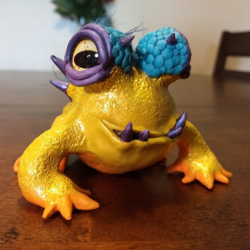 Tusked Toad Sculpture