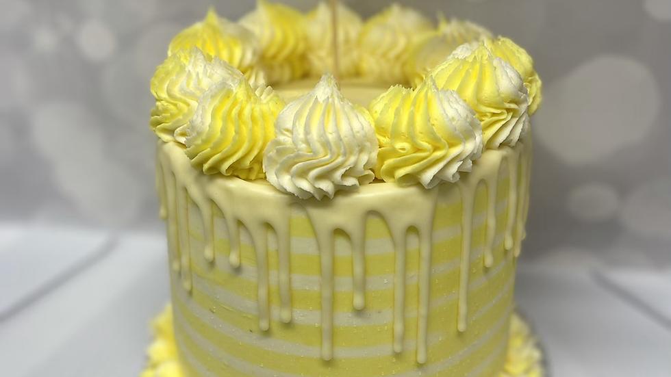 Lemon pinstripe cake with Happy Birthday topper