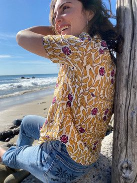 Lounging on the shore with a seahorse block print shirt