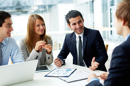 Image of business partners discussing do