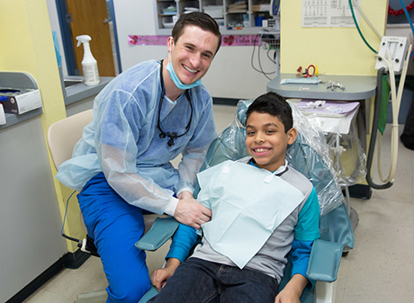 Dentist and patient -460
