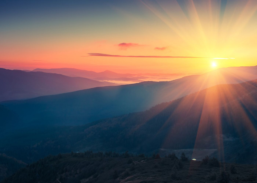 Gorgeous sunrise over distant mountains - Start your day by setting yourself up for success