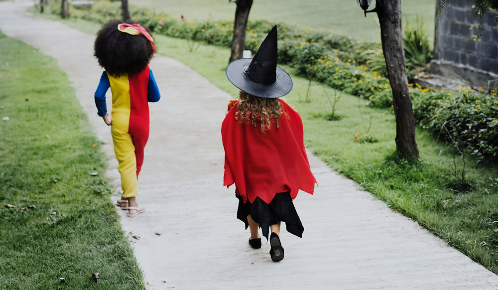 two girls running in costumes