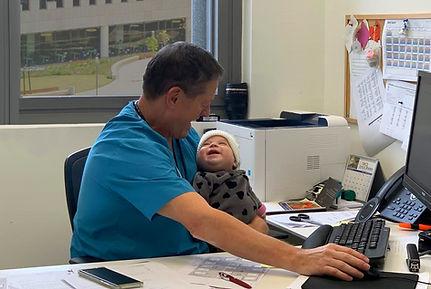 Dr. Omer Globes & baby 3.jpg
