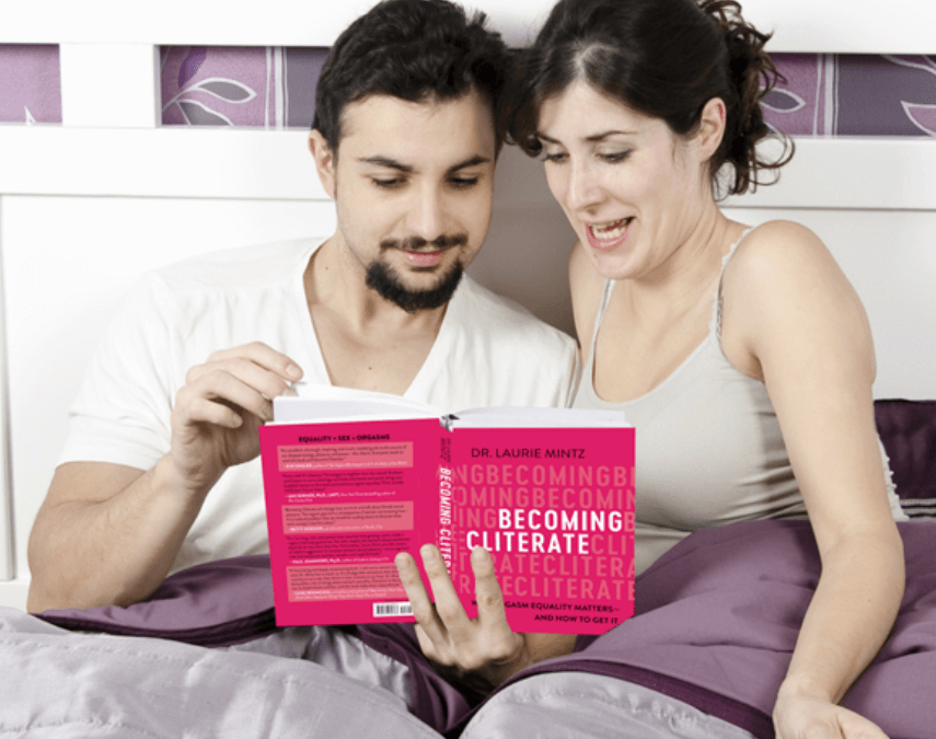 Couple reading sex book in bed