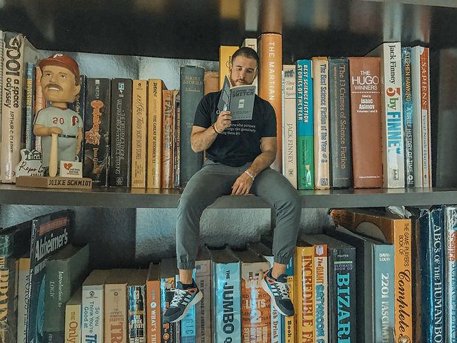 Sitting on book shelf.jpg