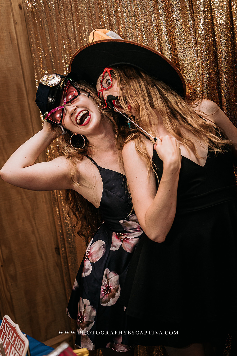 2 women with silly hats and glasses