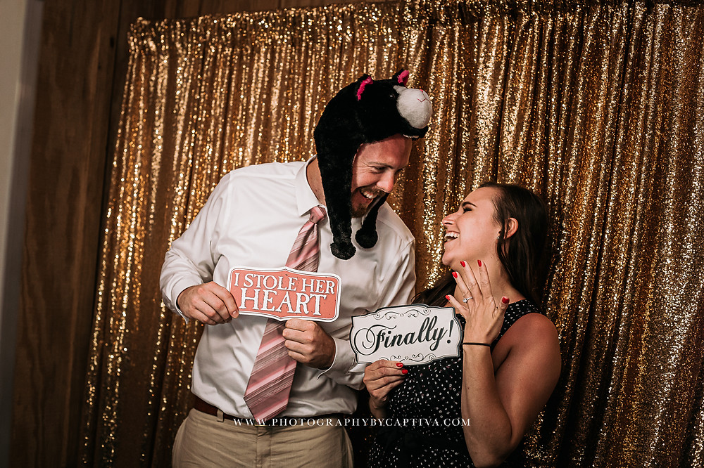 Engaged couple in the photobooth