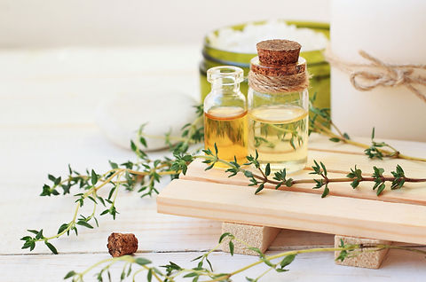 Thyme essential oil. Bottles with extrac