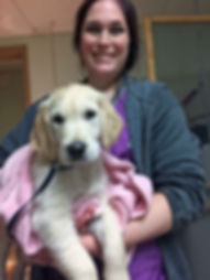Alecia grooms a new pup.