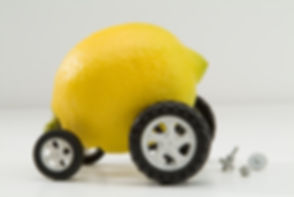 Broken down Lemon with wheels and car p