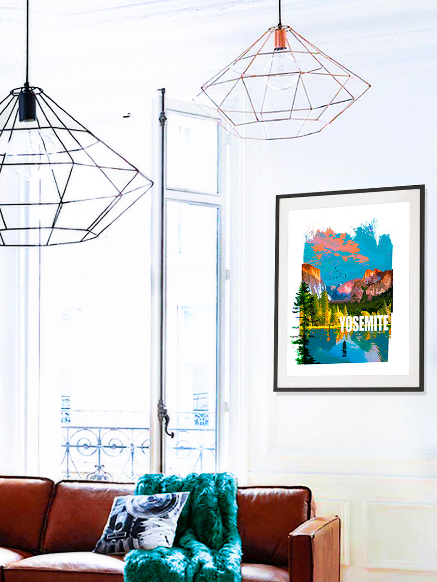 A framed fine art print of Yosemite National Park hanging on a wall in a home
