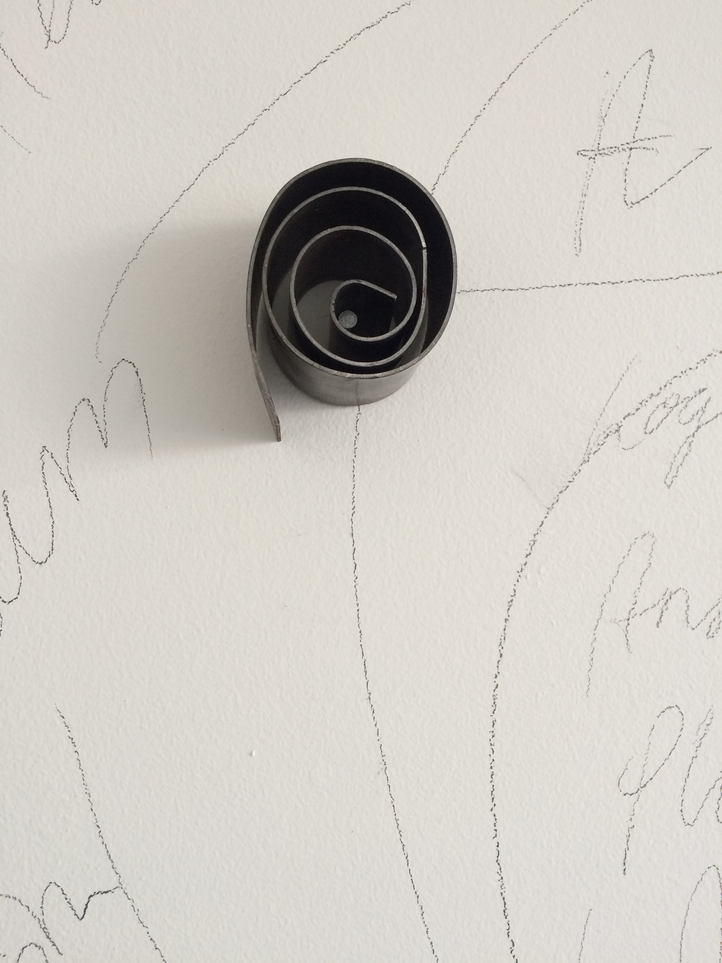 folded metal on nail in studio