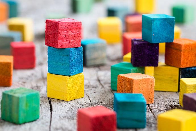 Colorful wooden building blocks. Selecti