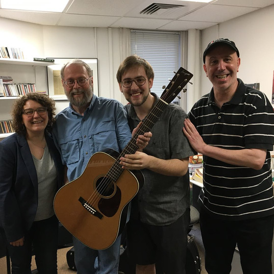 Kim Perlak, Dana Bourgeois, and Matt Glaser presenting me with the Courtney Hartman American Roots Guitar Award in 2018
